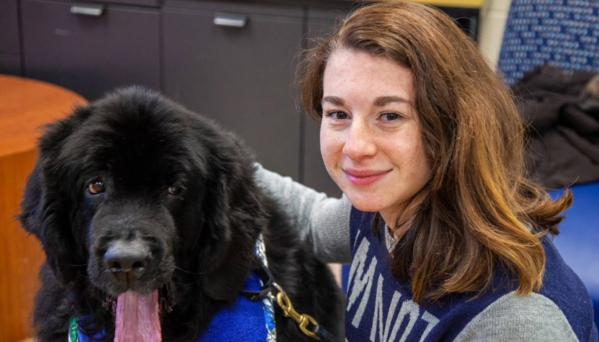 QCC student Regina Slootsky takes a break from studying with a furry new friend.