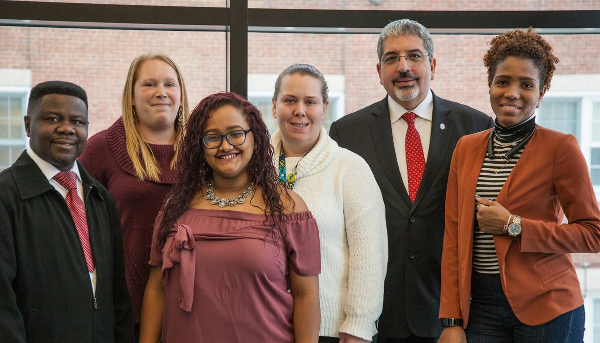 QCC President Dr. Luis Pedraja stops to visit with a group of QCC students in this 2017 photo.