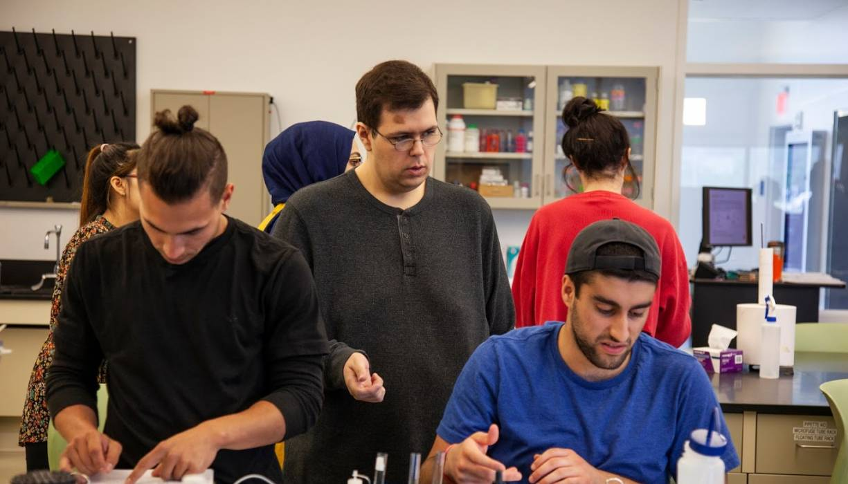 Recent QCC graduate Richard Smith (center) is one of the Biology lab support technicians.