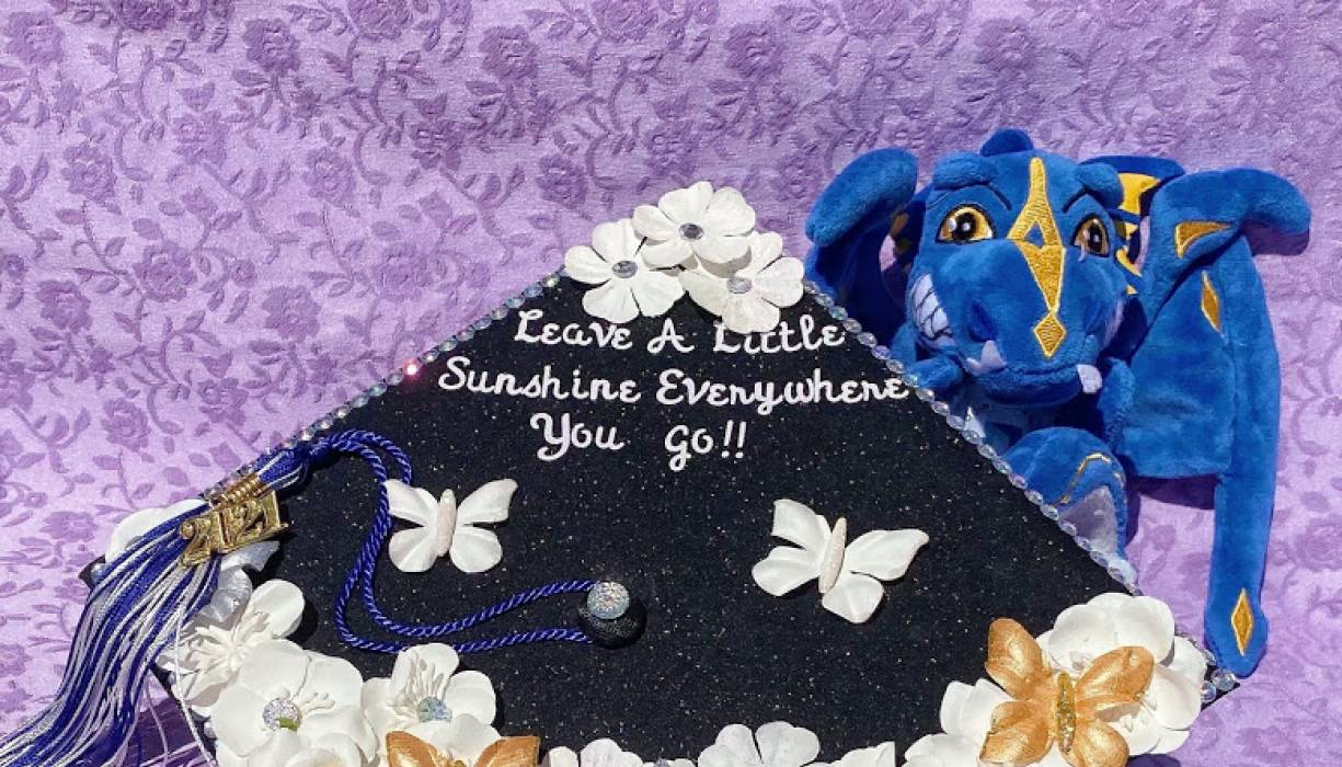 QCC Grad Shauna Connelly reminds everyone to leave a little sunshine everywhere they go.