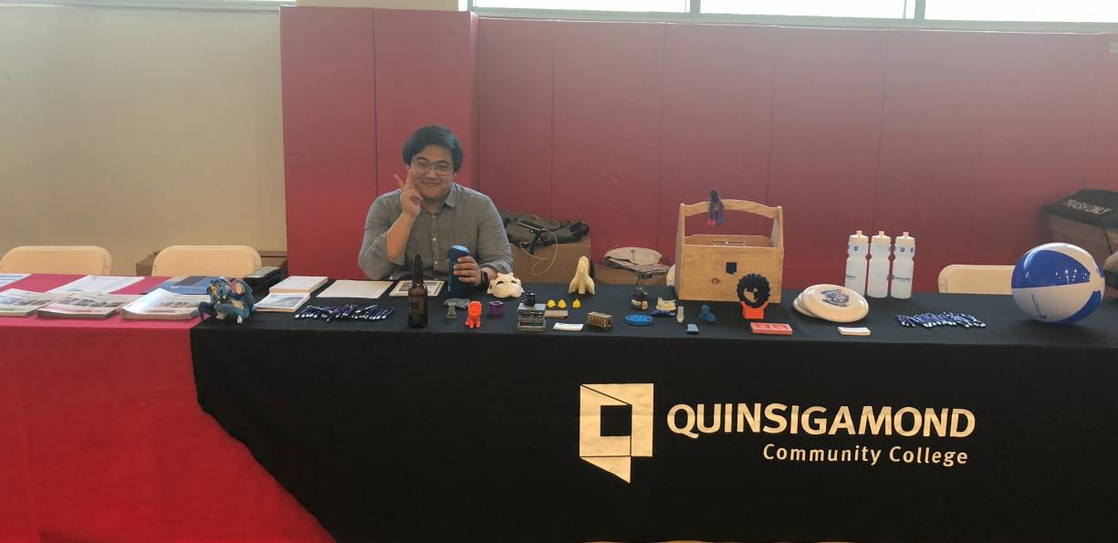 QCC student Brandon Won showcases Fab Lab creations at the TouchTomorrow event.
