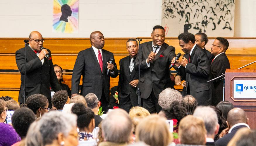 The audience enjoys the soulful music from the Knights of Zion Men's Choir.
