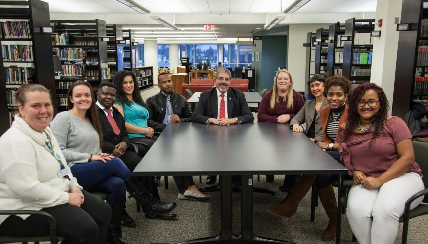 Dr. Luis Pedraja (center) takes an opportunity to speak with some QCC students.