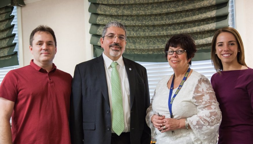 From left: Tony Sanders, QCC President Dr. Luis Pedraja, PTK Advisor Bonnie Coleman and PTK member Kayla Patterson.