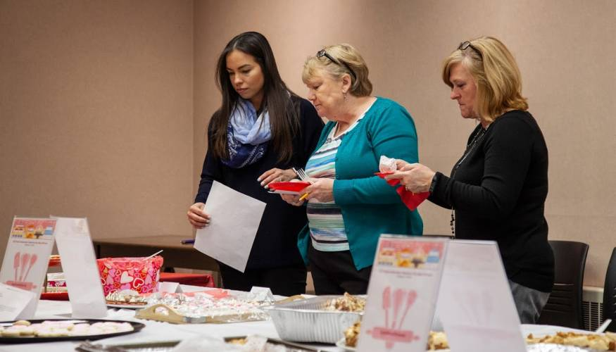 Voting is very serious business at QCC's Alumni Association Bake-Off.