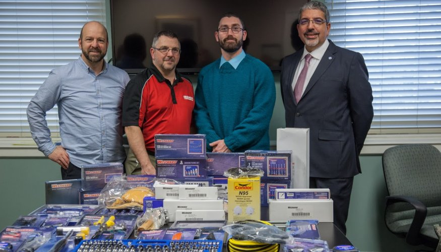 From left: Lee Duerden, Assistant Professor of Manufacturing Technology; Edward Weatherbee from Grainger; QCC Student Jason Butler and QCC President Dr. Luis Pedraja stand in front of Mr. Butler's new tools.