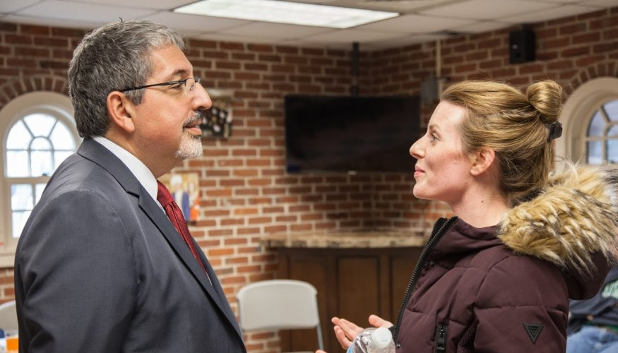 Dr. Pedraja discuss concerns with a student at the recent Pizza with a President event.