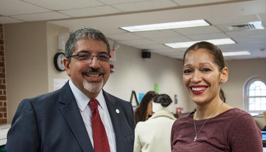 Dr. Pedraja talks to QCC student Nelly Medina.