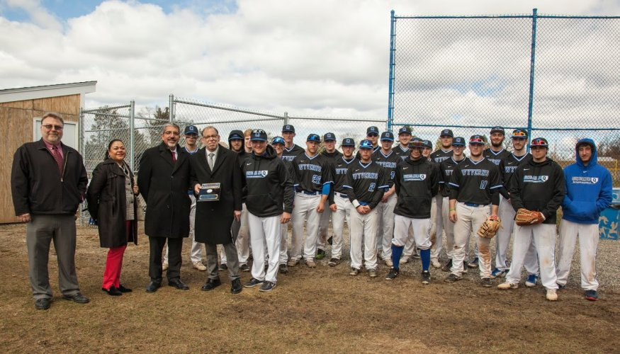 QCC's Baseball Team Presents Plaque to Steve Marini and Jim Racki.