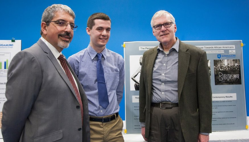 From left: President Dr. Luis G. Pedraja, QCC student presenter Nathan Hess and Michael Stevenson, Coordinator of Library Collection Development.