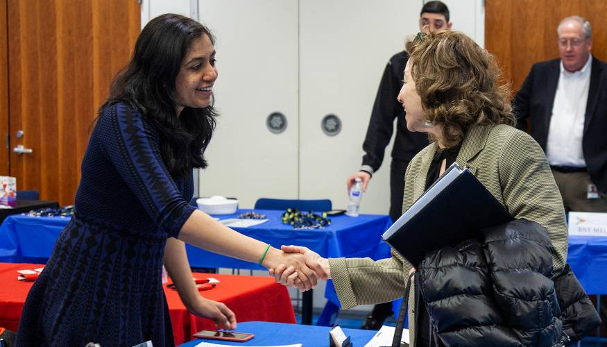 A QCC student networks with a potential employer.