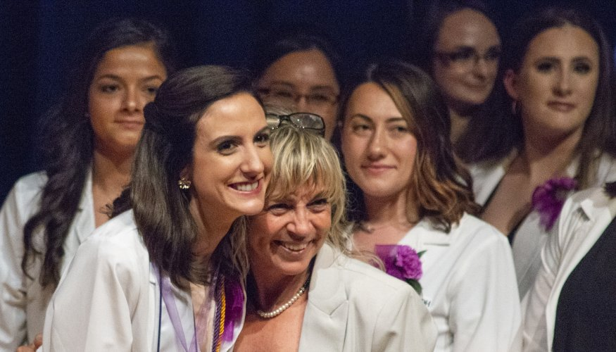 Sharing a special moment at the Dental Hygiene Pinning ceremony.