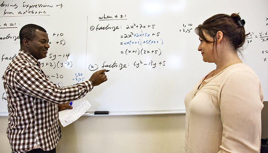 At a recent QCC Math Boot Camp Associate Professor Sheiba Mas-Oud explains a mathematics problem to student Bethany Bailey.