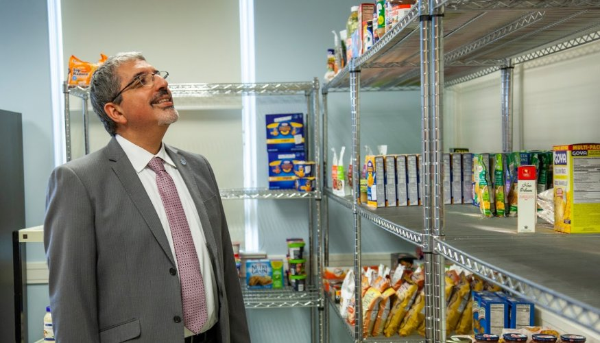 Dr. Luis Pedraja visits the food pantry as it begins to get stocked.
