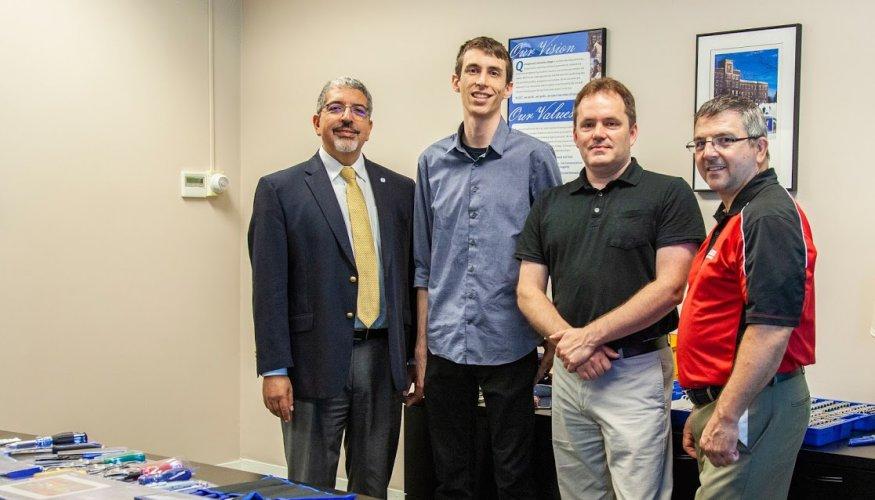 From left: Dr. Luis Pedraja, Robert Allred, Tony Sanders and Edward Weatherbee, of Grainger.