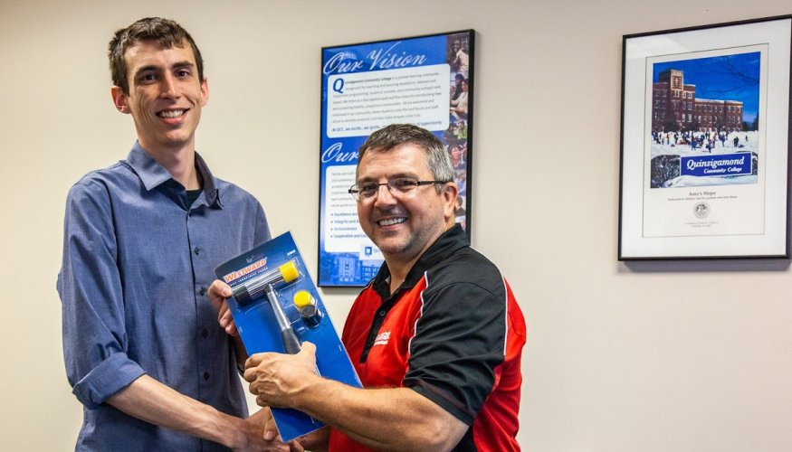 Robert Allred (left) is congratulated by Edward Weatherbee, of Grainger.