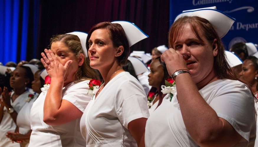 Recent graduates shed tears of joy at their pinning ceremony.