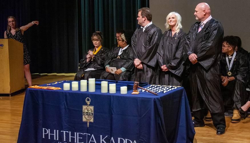 PTK Alumni Advisor Kayla Paterson gestures to the new PTK Alumni Board members.
