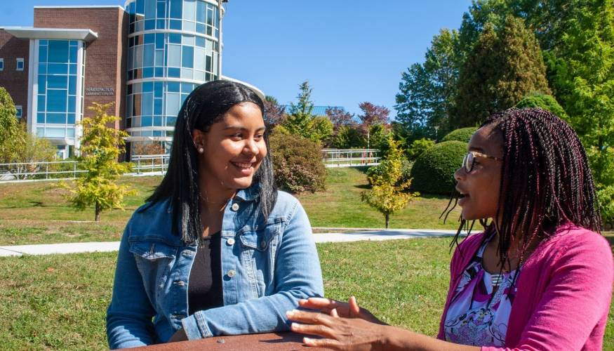 Student mentee Zuheyry Encarnacion shares a laugh with her mentor, Dr. Natalie Anumba.