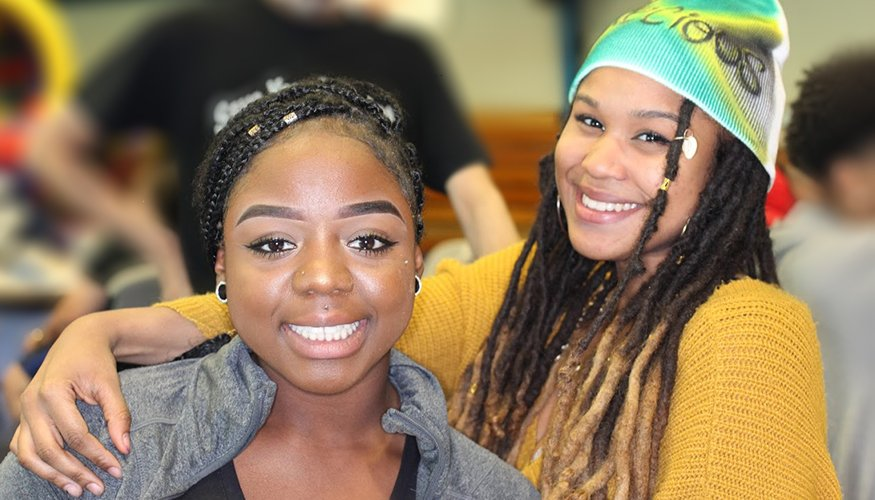 From left: QCC students Rebecca Owusu and Precious Love are all smiles at QCC's Spirit Carnival.
