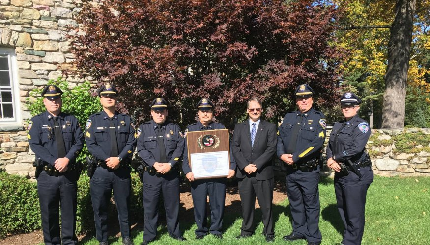 QCC Campus Police receiving their Accreditation Award at the Connors Center in Dover, MA.