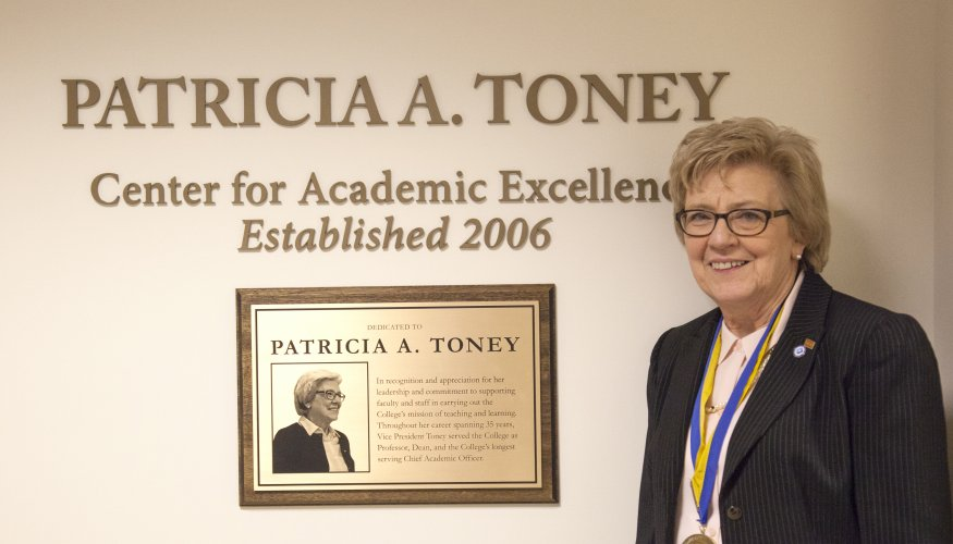 Pat Toney poses with plaque