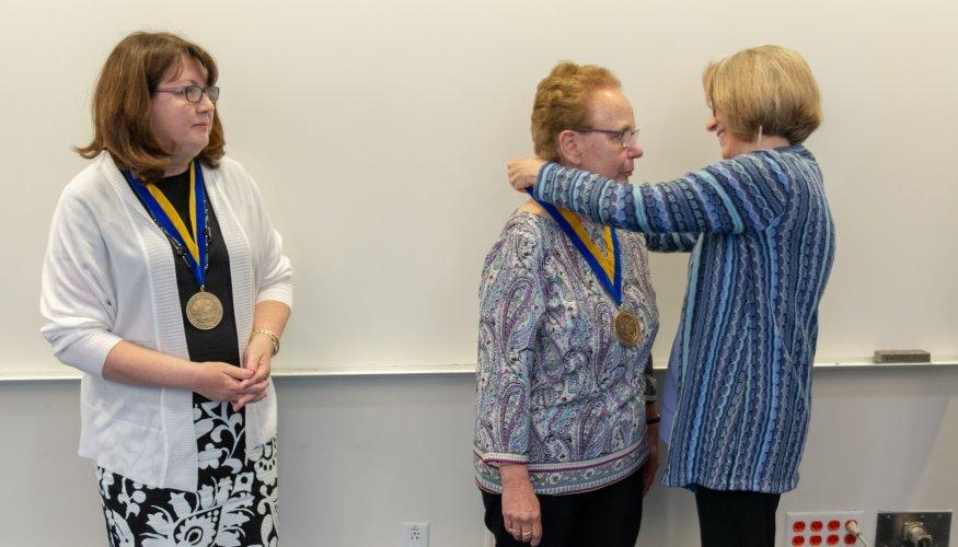 Eileen Potvin looks on as Priscilla Underwood receives the honor of Professor Emerita.