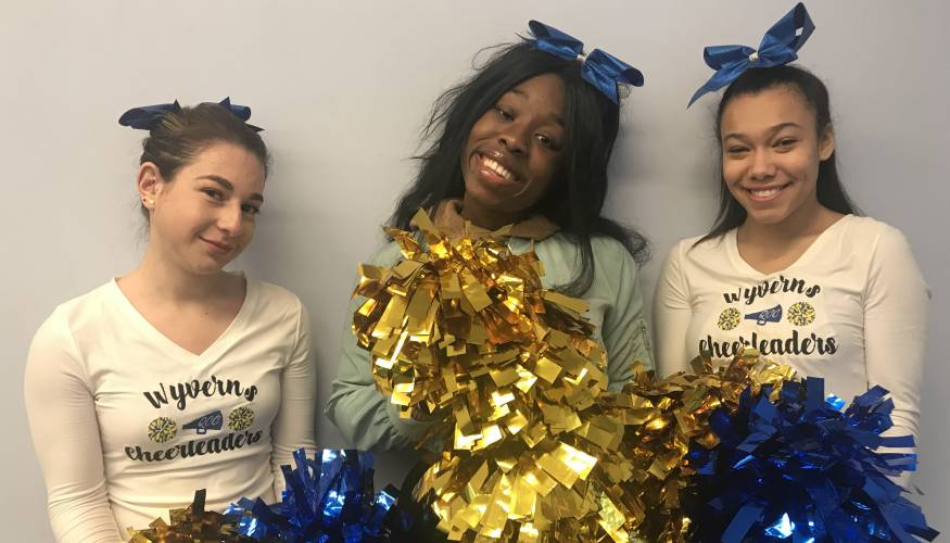 QCC Cheerleaders from left: Regina Slootsky, Tamara Charles and Amerlin Vasquez