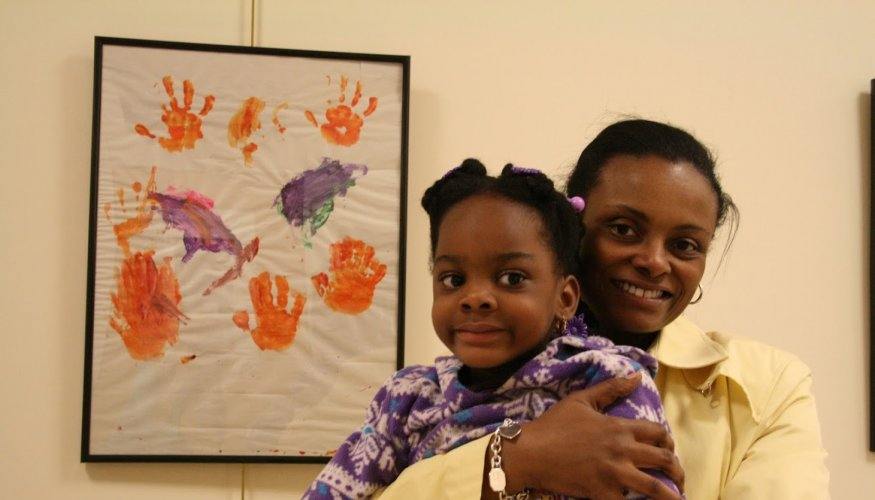 QCC's Dean of Enrollment Michelle Tufau Afriyie with her lovely daughter.