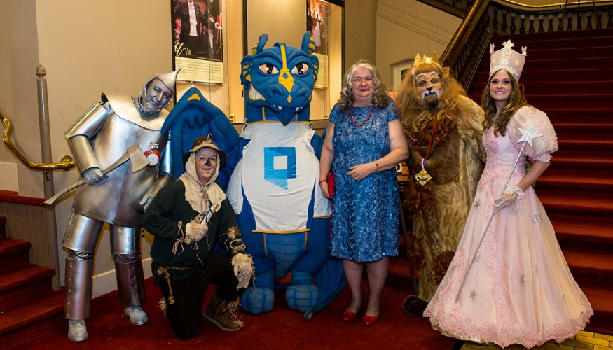Gail poses with Wizard of Oz characters at Gala