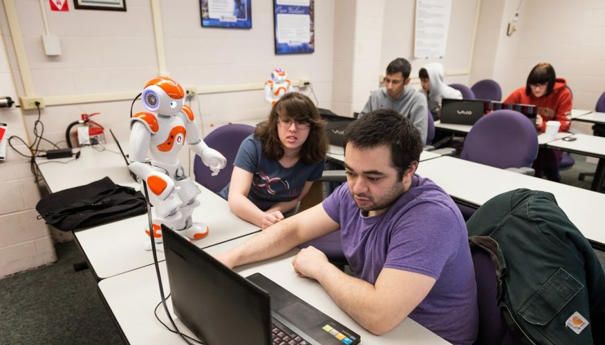 QCC students work with a robotic friend.