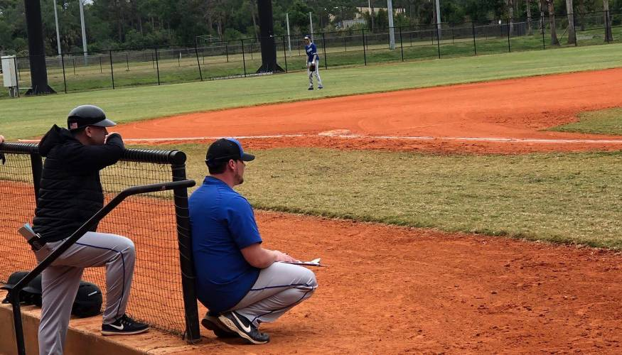 QCC coaches give instruction to their players during the Men's Baseball team's spring training in Florida.