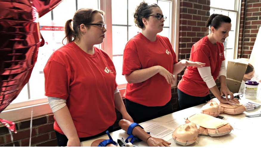 Senior nursing students in the Advanced Placement Nurse Education Program teach hand-only CPR.