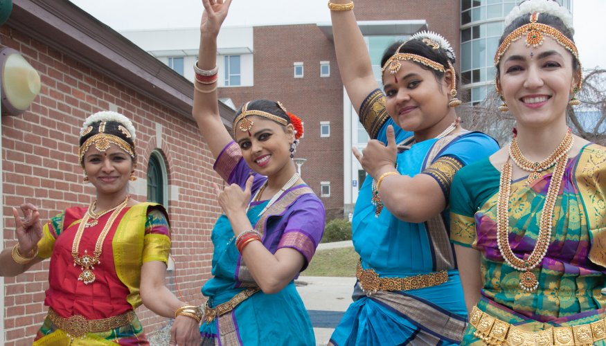 students in authentic cultural garb