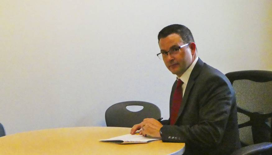 Southbridge Receiver/Superintendent of Schools, Dr. Jeffrey Villar signs the Memorandum of Understanding (MOU) with QCC.