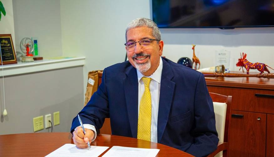 QCC President, Dr. Luis Pedraja signs the a Memorandum of Understanding (MOU) with Southbridge Public Schools.