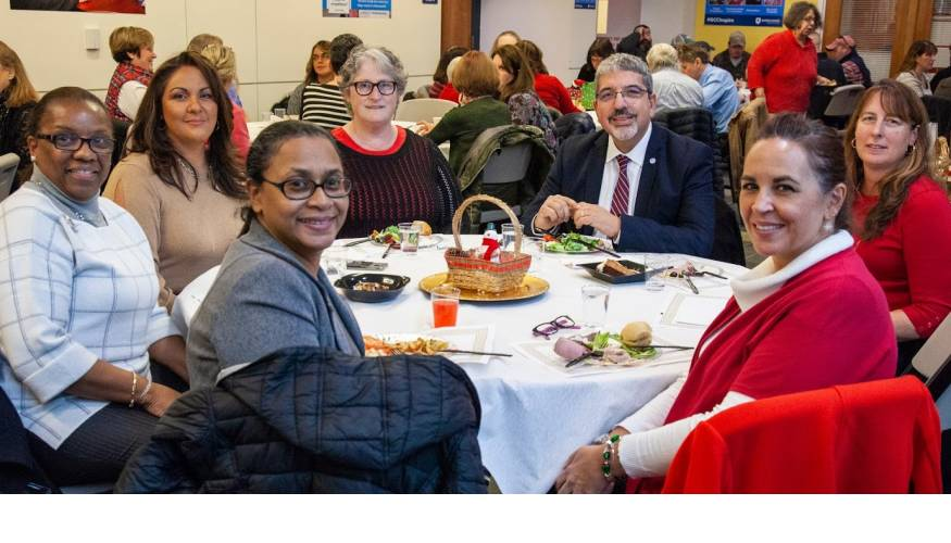 QCC President Dr. Luis Pedraja and his table mates at the annual holiday luncheon.