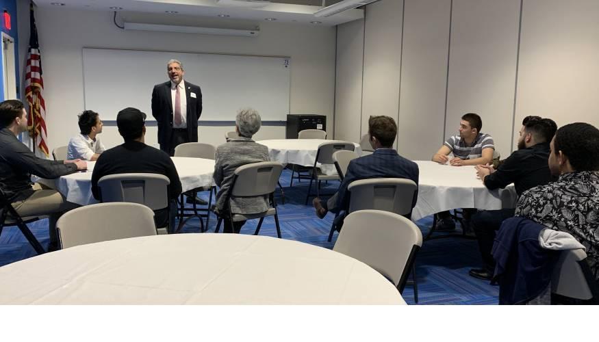 QCC President Dr. Luis Pedraja addresses scholarship recipients.