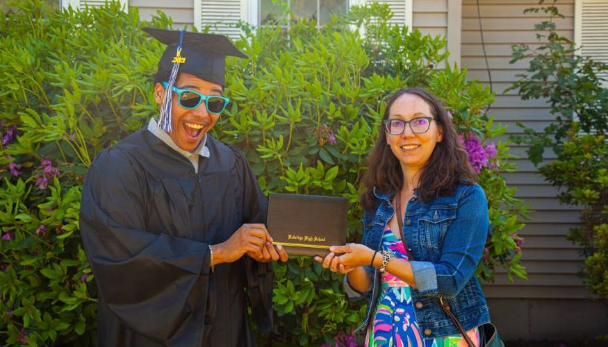 Gateway graduate receives his diploma from Gateway to College Resource Specialist, Jenna Glazer.