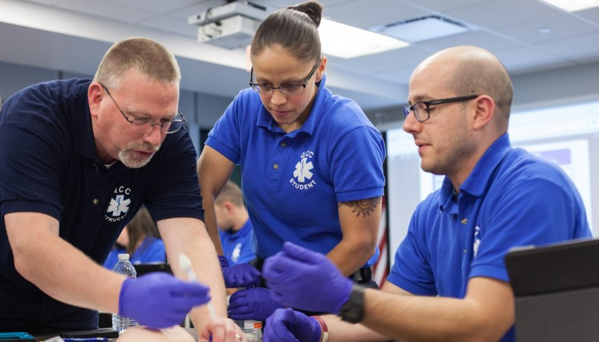 QCC Paramedic students get a refresher course in how to administer Narcan.