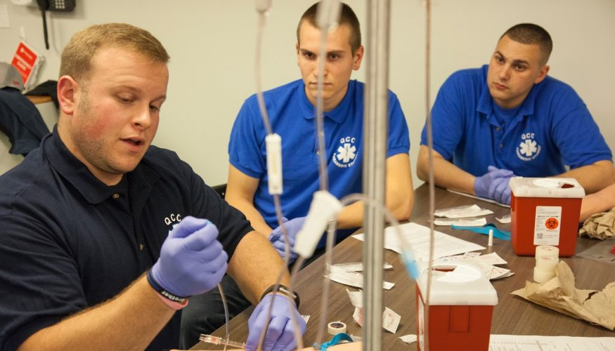 QCC paramedic students learn how to administer IV medications.