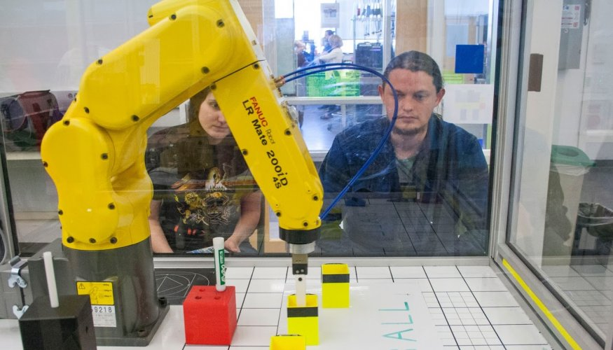 A Fanuc Robot is programmed to do the perfect pick up.