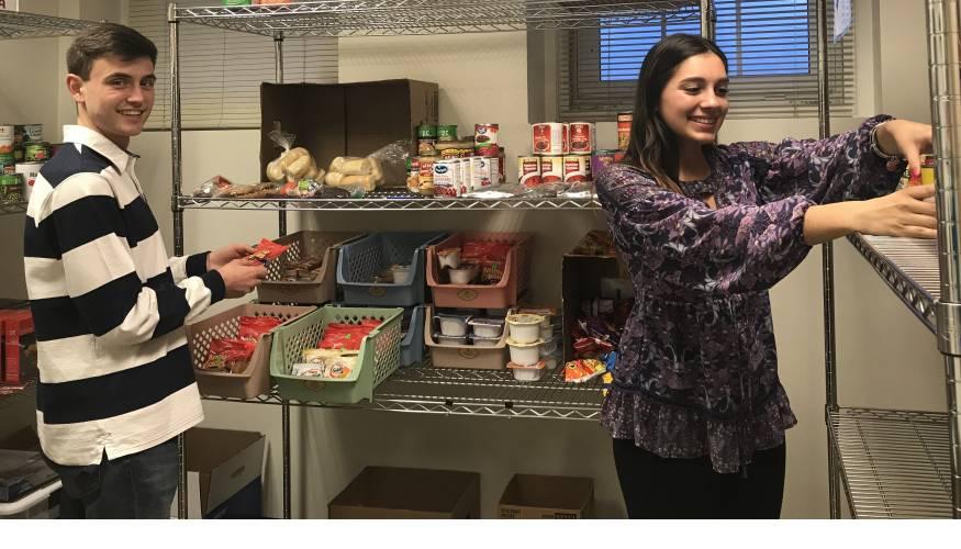 PTK Food Pantry Manager Max German and student volunteer Alexandra Hernandez