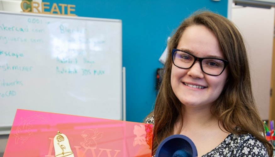Olivia Howard shows off the projects she made using the Fab Lab's 3D printers and laser cutter.