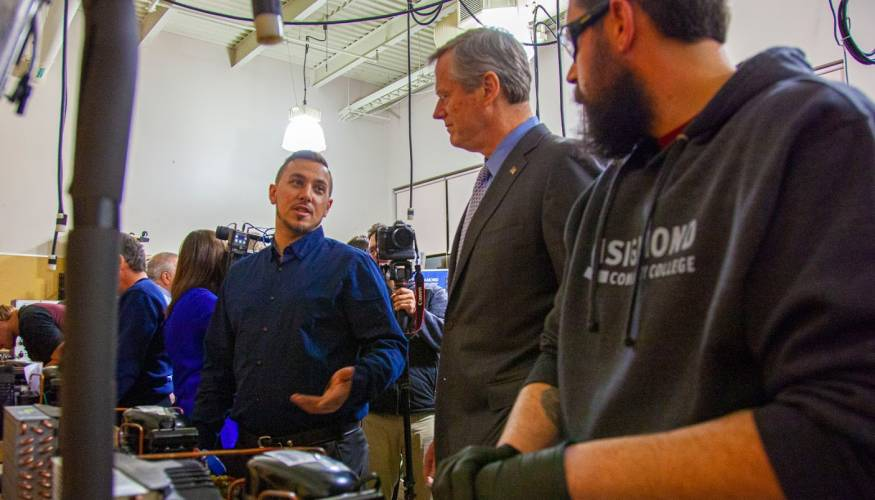 QCC students show Governor Baker the HVAC lab at WTHS.
