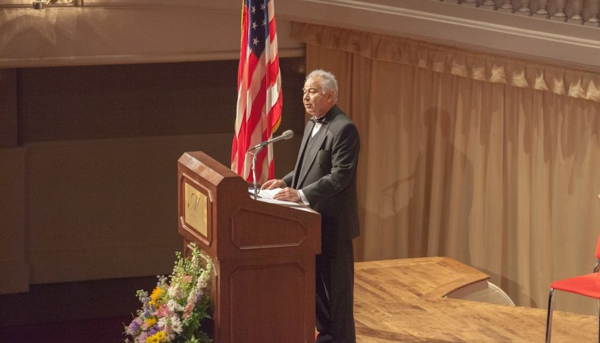 Professor Dadbeh Bigonahy speaks at an Honors and Awards Ceremony.