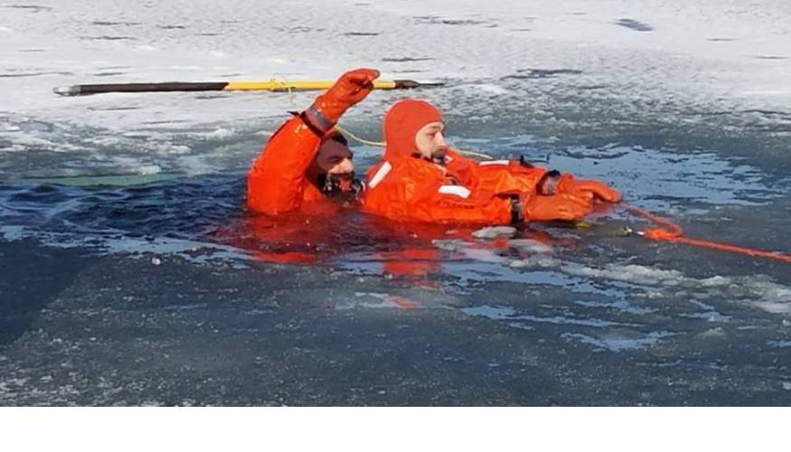 Sutton Fire Department District Fire Chief Robin Dresser (L) and Sutton Selectman Jess Limanek (R) during ice rescue training.