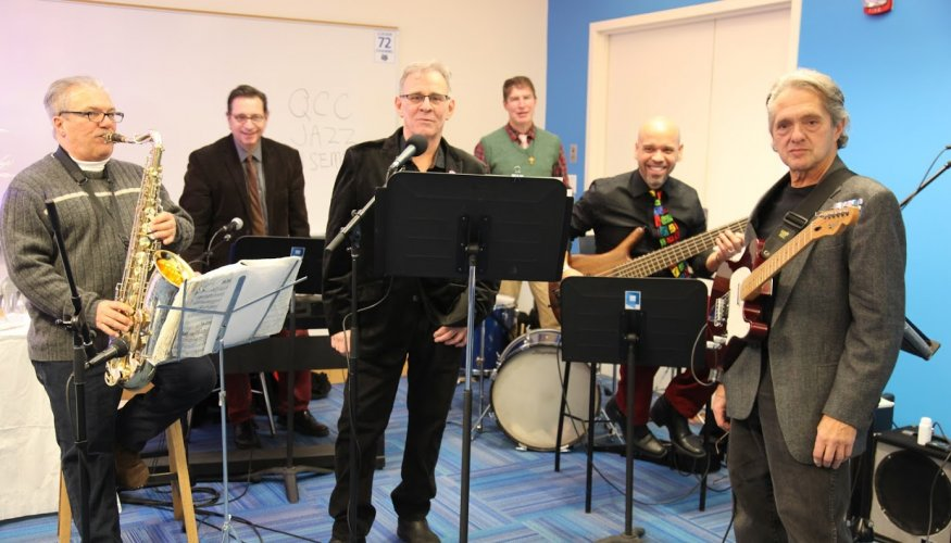 QCC's Jazz Ensemble, from left: Tom Hebert, Maura DePasquale (WCCA Station manager), Ricky Ricardi Jose Castillo, Joey D'Angelo and John Solaperto (center).