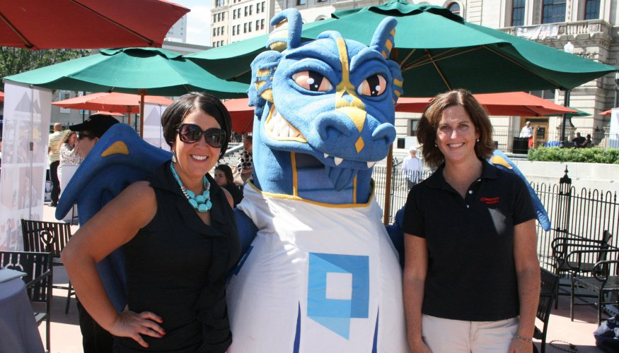 fair attendees pose with wyvern at Uncommon Job Fair