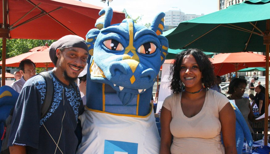 Students pose with wyvern at Uncommon Job Fair